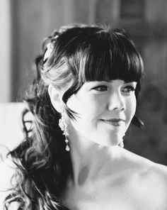 Long, romantic curly ponytail with bangs (Photo by Mary Sylvia Photography)