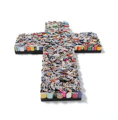 "Cross Made from Recycled Magazines - Measures 6-1/2"" wide x 9"" tall x 1/2"" deep and each cross comes with a hook for hanging. ($52.00)"