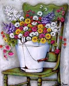 Very colorful flower bouquet in large metal bucket on a green chair, by Stella Bruwer