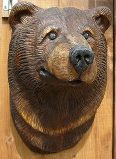 peeweewoodcarving.com  carved bear mount.  265.00 free shipping