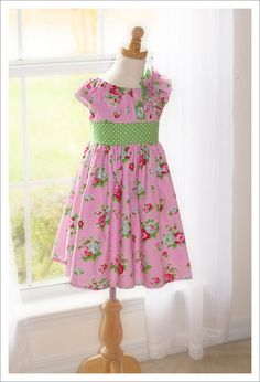 I love the Olivia dress designed by Olabelhe, offered by KinderKouture.