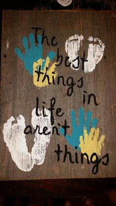 Christmas present for grandparents with the boy's foot and hand prints with a cute saying over top.
