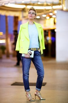 Angie Cox in pale blue fuzzy sweater with citron wool coat. Fresh color mix.