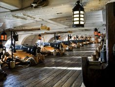 The Lower Gun Deck of the HMS Victory.   Nelson's flagship - HMS Victory. Best known for her role in the Battle of Trafalgar, the Victory currently has a dual role as the Flagship of the First Sea Lord and as a living museum to the Georgian Navy.