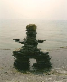 Metallic Print Inukshuk on The Shore Looking Out by TheOldBarnDoor