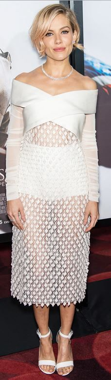 Who made  Sienna Miller's jewelry and white dress?