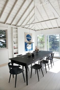 I like how the black table/chairs anchor the space with the tall, white ceiling.