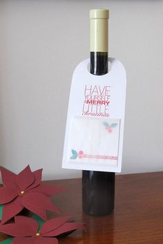 Going to a great holiday party? Youll need a hostess gift and this handmade gift tag is the perfect way to top it off! Christmas bottle gift