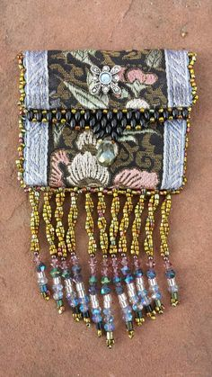 Check out this item in my Etsy shop https://www.etsy.com/listing/263195999/beaded-gift-bag-native-american-inspired