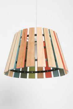 DIY Lamp shade: use paint stir sticks & whatever colors. This is awesome!  Could do the colors on the inside OR outside!