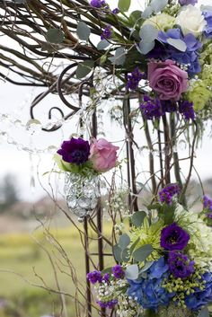 arch décor idea - sticks and flower bunch at the side? @Lauryn Wannamaker