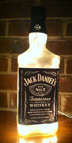 https://www.etsy.com/listing/206366914/jack-daniels-frosted-lighted-bottle-lamp see more at http://www.lightitupcreations.blogspot.com/?m=1 #bottle #seasonal #whiskey #frosted #lighted #lamp #jackdaniels #bar