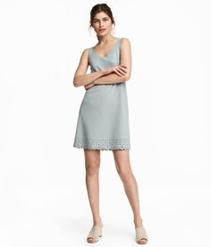 Check this out! Short, sleeveless, straight-cut dress in crêpe jersey.  Decorative scalloped edge at neckline and armholes, and hole pattern at hem. Unlined. - Visit hm.com to see more.