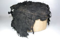 Journal of Archaeology in the Low Countries Fig. 5 Hat or headdress found in Dokkum (object nr. a1913/11.223D). The hat was made out of naturally brown wool which was dyed deep brown. The wool used for the decorative stitching was not dyed (collection National Museum of Antiquities Leiden).