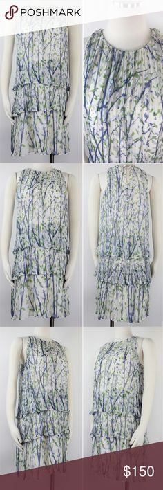 """Adam Lippes Watercolor Floral Silk Tiered Dress 4 Adam Adam Lippes Women's Dress Ivory Flowy 100% Silk Gauze Pleated Sleeveless Floral Tiered Trapeze. Pull Over with Eye Hook Closure. Lined. Retails $495 Size: 4  Shoulder: 9""""  Waist: 37.5""""  Length: 17.5""""  Condition: Excellent Used Condition - Almost New!. Comes from a pet and smoke free environment!  Please review pictures and contact me if you have any questions. Color: Ivory  Pattern: Floral Material: 100% Silk Country: China Care: Dry…"""