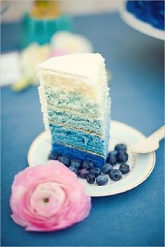 ombre blue wedding cake with pink ranunculus for detail