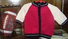 free.,Baby's Letterman Jacket calls for 5 skein of Tahki Stacy Charles Cotton Classic: 2 red, 1 white, 1 black, 1 silver or substitue your own team's colors.