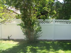 Lattice top fence with specifically chosen plants insulates natural beauty with a layer of privacy to your yard.  It includes a decorative element that repeats the design in the fence.