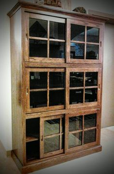 NEW Sliding door bookcase!  Hand crafted by Ohio's Amish artisans from sustainably harvested hard wood.   #amishoriginals