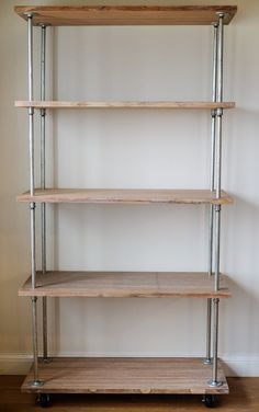 Make an Industrial-Style Shelving UnitStorage Shortage? Make an Industrial-Style Shelving Unit Diy Storage Shelves, Pipe Shelves, Garage Storage, Storage Ideas, Garage Organization, Wood Shelves, Organization Ideas, Rolling Shelves, Kitchen Shelves