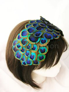 7cc7bb44d3dd Peacock feather fascinator - Bonnet style with over 60 peacock feather eyes  from ear to ear