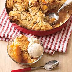 Skillet Peach Cobbler   16 T (2 sticks) unsalted butter, cut into pieces 5 ripe but firm peaches, peeled, pitted, cut into 1/2-inch-thick slices 3/4 cup sugar 1/2 teaspoon cinnamon Salt 2 cups all-purpose flour 2 1/2 teaspoons baking powder 2/3 cup milk 1 teaspoon vanilla extract 1/3 cup sliced almonds, optional Vanilla ice cream, optional