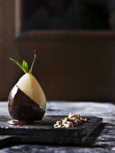 Pear dipped in dark chocolate. Such an elegant dessert and so simple.