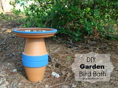 DIY Garden Bird Bath Project made from terra cotta pots and saucer.