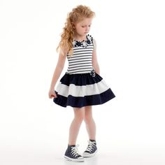 This navy blue and white striped dress is designed by Kate Mack & Biscotti. It is made in a comfortable cotton, with pretty floral appliqué and tie fastening on the back. Cute Little Girl Dresses, Baby Girl Dresses, Baby Dress, Tween Fashion, Baby Girl Fashion, Toddler Fashion, Baby Clothes Patterns, Kids Frocks, Toddler Dress
