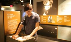A visitor has a look through Eleanor Roosevelt's FBI file, found at the new permanent exhibition at the Franklin D. Roosevelt Presidential Library and Museum in Hyde Park, NY.