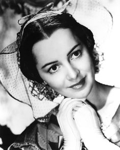 "Olivia de Havilland (as Melanie Hamilton Wilkes) in a publicity shot for  ""Gone With The Wind."""
