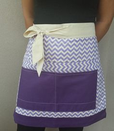 Perfect for BBQing, cooking, gardening, painting or making crafts. It is a modern half apron made with quality fabrics and lining in the back for better protection and resistance. Its colours make it the perfect little touch featuring 4 pockets to keep essentials items and tools.  This beautiful design has the best quality in craftsmanship.  Now available in these two different designs!