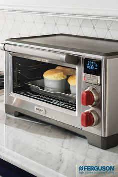 Test Kitchen Showrooms This Wolf Gourmet countertop convection oven is a great side-kick as a second or third oven to tackle the job of cooking side dishes and appetizers while the main oven is in use. Who says good things have to wait? Small Appliances, Kitchen Appliances, Kitchens, Countertop Convection Oven, Oven Racks, Grill Rack, Fun Cooking, Gourmet Cooking, Cooking Games