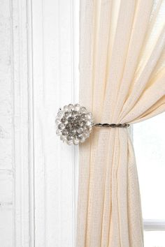 I love this window treatment tie back. It would work great in a room that had glass or similar material knobs on dressers.