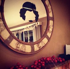 1920s party decor! Use black poster board cut out the shape and tape to a mirror! Super easy and cute decoration :)