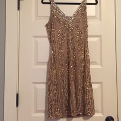 Hannah Joe beige & gold beaded sheath dress Hannah Joe beige & gold beaded sheath dress - size M - beige sheath with gold sequins, beads, and crystals - NEW, never worn, with original tags Hannah Joe Dresses