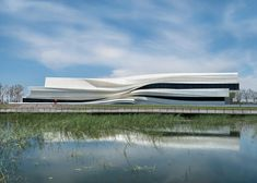 Undulating facade of Yinchuan art museum references the gradual shift of a Chinese river.
