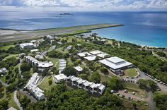 Aerial view of University of Virgin Islands - St. Thomas, USVI. Airport in background. Brewers Bay Beach on right.