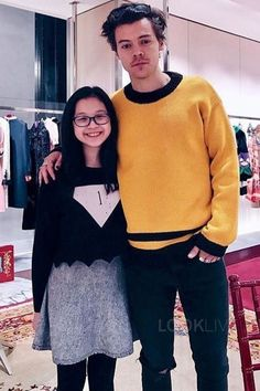 Harry Styles wearing  Gucci Wool sweater with contrast trims, Saint Laurent Skinny-Fit 15cm Hem Distressed Raw Stretch-Denim Jeans