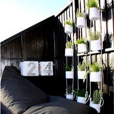 Vertical flowerpots , Trimm Copenhagen. Spotted by Design Circus.