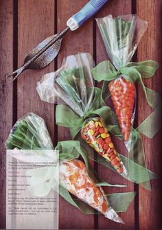 Carrot candy bags. Fill an Icing Bag with orange candy, and tie off with some green ribbon. Add some green tissue to the top of the carrot