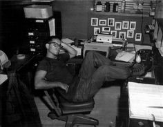 Writing on back of photo:  This is me working hard at my desk during combat duty in Vietnam. You'll love the Infantry. Heard you scored quite hi on your test. Better learn your job well. This is what I do most of the time - sucks- just got back from Tuy Hoa. Cong had nerve to shoot at us. Didn't like that to well. Had 7 rockets dropped on us last night - just missed shell oil plant that would have neat! Rockets are fun to watch, but bounce one around a bit.