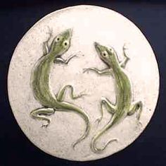 Round relief carved, hand painted tile