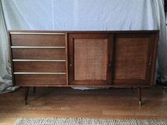 RARE Mid Century Modern credenza designed by John Keal for Brown Saltman of California. 4 drawers with brass edges. 2 removable sliding doors and an adjustable shelf  Great condition with the exception of a chip on the left side lower bottom (shown in pics). Brown Saltman furniture is highly sought after. This piece is worth $2500-3000 on 1st Dibs, at gallery or vintage furniture store, but selling it at a discount due to chip.  60 long X 33 tall X 18 deep  Free pick up only or local (150…