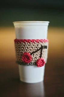 Add some fun to your coffee shop experience by making these unique and reusable coffee cup cozies. Crochet Coffee Cozy, Coffee Cup Cozy, Mug Cozy, Coffee Shop, Pumpkin Stem, Reusable Coffee Cup, Flower Center, Loom Knitting, Knitting Ideas