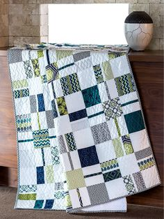 This refreshing white quilt is reminiscent of the first sprigs of green grass after the long winter.