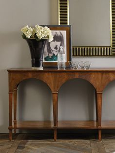 We like the arches in this piece... not sure about the lower shelf.