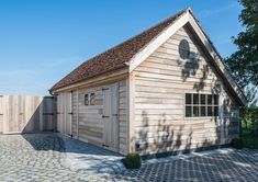 Landelijke houten garage met berging - Woodarts
