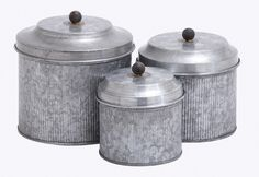 """Uma Galvn Metal Canister (Set Of 3) 8"""",7"""",6""""H 38164 - Uma Galvn Metal Canister (Set Of 3) 8"""",7"""",6""""H 38164Set Of Three 8"""", 7"""" And 6"""" Farmhouse Rustic Galvanized Round Iron Canisters With Lids, Hammered Finish With Fine Vertical Ribbing On Canister And Smooth Finish Tiered Lids With Oxidized Black Iron Ball Knobs.SKU: 38164Manufacture: UmaMaterial: IronColor: Distressed Gray, Oxidized BlackFinish: Distressed RusticTheme: FarmhouseProduct Type: JarShip By: UPSUPC Code: 7586473816..."""