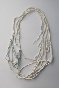 """Patricia Gallucci, necklace, 'Reconstruction' Paper clay porcelain, underglaces, baby merino fibre wool. Mixed technique, 2014 From the """"Broken"""" series"""